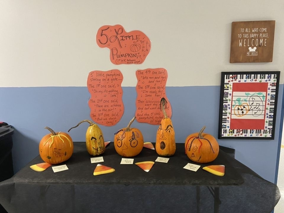 "Mr. Skiles, our new music teacher at RBES, created a wonderful pumpkin display for our students to enjoy. Five  Pumpkins are singing the song ""5 Little Pumpkins"" This project was completed by RBES Kindergarten and 1st grade students."