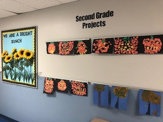 Student work hanging in hallway, pumpkins