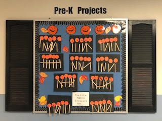 Pre-K pumpkin project hanging in hallway